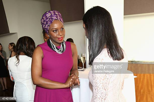 Author Chimamanda Ngozi Adichie speaks with guests during the Girls Write Now Awards honoring Chimamanda Ngozi Adichie Pamela Paul and Juju Chang at...