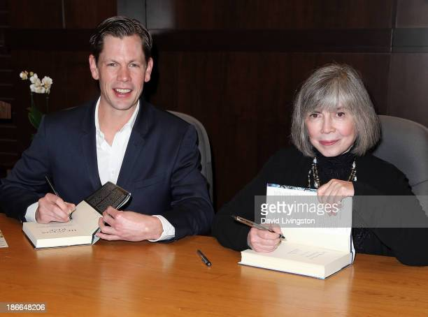 Author Christopher Rice and mother author Anne Rice attend a signing for their books 'The Heavens Rise' and 'The Wolves of Midwinter' respectively at...