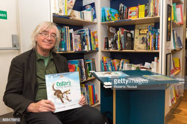 Author Colin Granger poses during a photocall to celebrate the publication of the new children's picture book 'Oskar's Amazing Adventures' at...