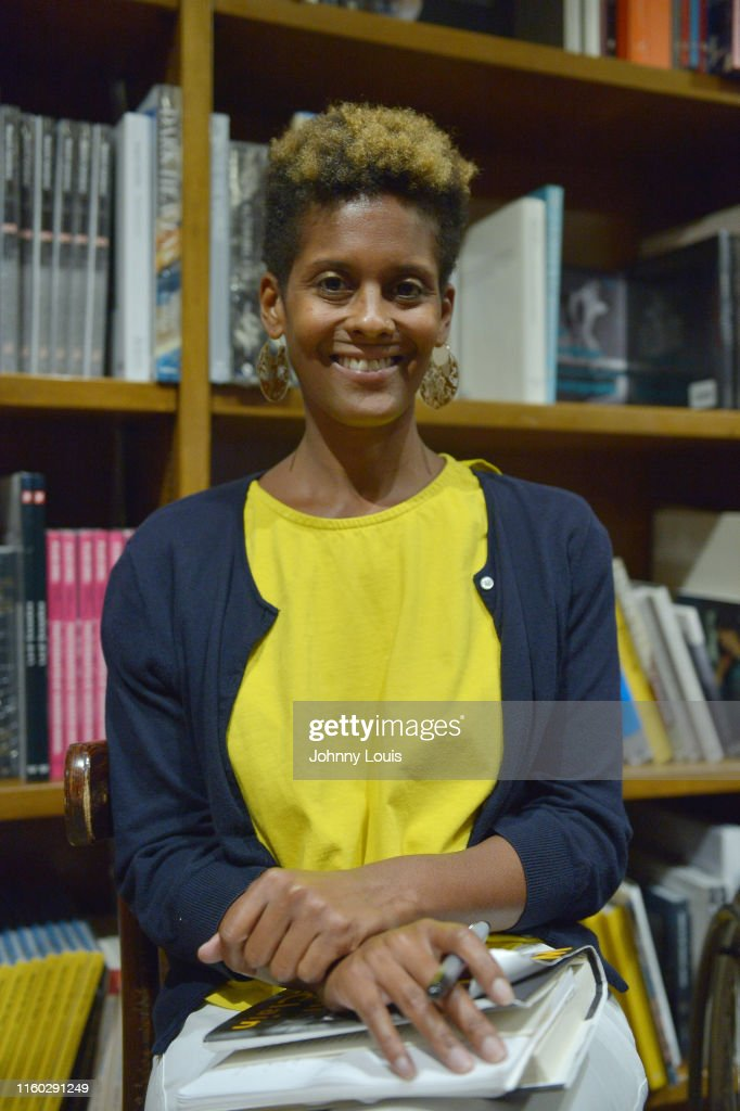 """Dani McClain Signs Copies Of Her Book """"We Live for the We: The Political Power of Black Motherhood"""" : News Photo"""