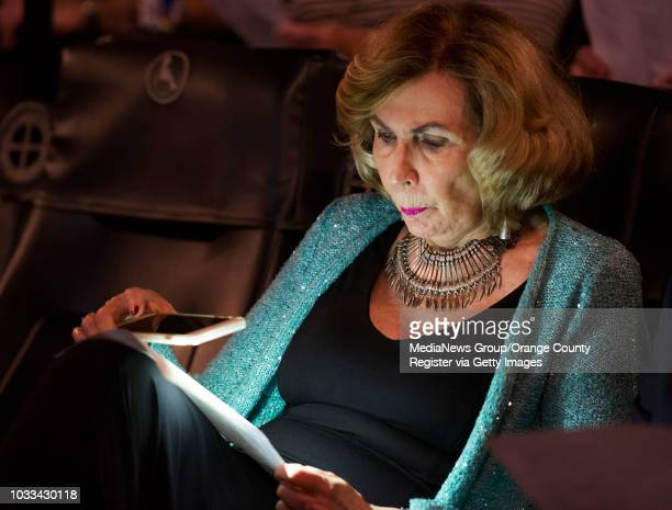 Author Darlene Quinn examines her Oscar ballot with the light from her cell phone during Robert Kline's annual Night at the Oscars event at the...