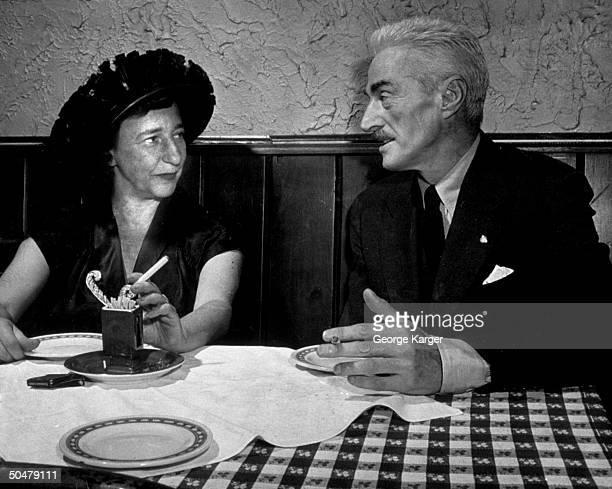 Author Dashiell Hammett writer lover Lillian Hellman chatting at table at 21 Club