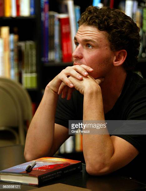 Author Dave Eggers takes a moment to talk with a fan during a book signing at Booksoup in west Hollywood on Saturday Oct 5 2002 He signed his latest...