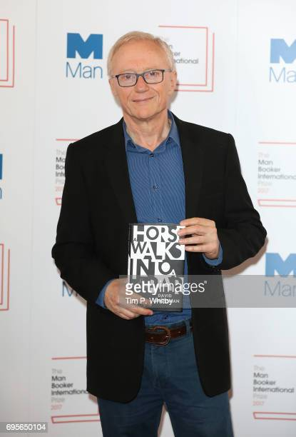 Author David Grossman of Israel with the book 'A Horse Walks into a Bar' at a photocall for the shortlisted authors and translators for the Man...