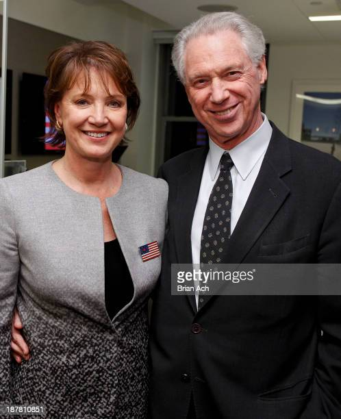 Author Diane Francis and husband John Beck appear at the Merger Of The Century By Diane Francis Book Release Party on November 12 2013 in New York...