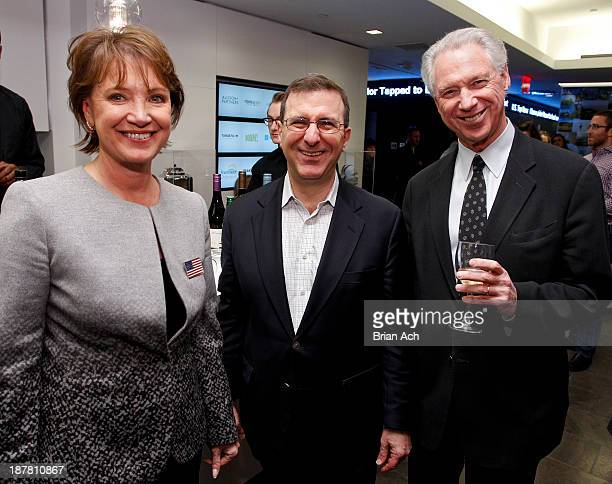 Author Diane Francis Richard Schwartz and husband John Beck appear at the Merger Of The Century By Diane Francis Book Release Party on November 12...