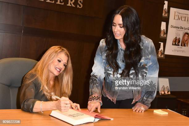 Author Dianna De La Garza autographs her first novel to daughter and singersongwriter Demi Lovato during the book signing of her new book 'Falling...