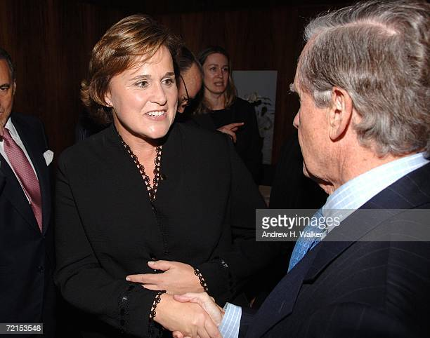 Author Doro Bush Koch greets James Robinson at a celebration for her book 'My Father My President' on October 11 2006 in New York City