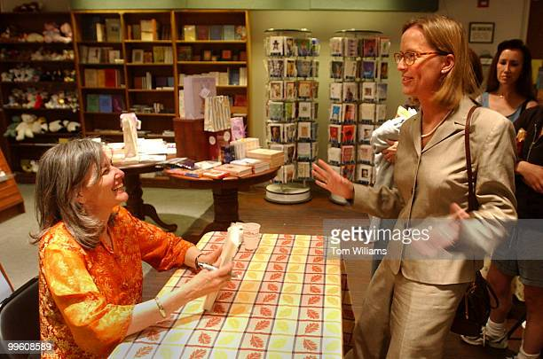 Author Elizabeth Berg sign books and talks with fans including Elizabeth Kendler right at Olsson's Books Records in downtown Washington DC May 17 2002