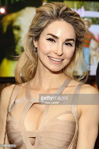 Author Elizabeth Tenhouten attends Much Love Animal Rescue's makeovers for mutts at Peninsula Hotel on March 14 2013 in Beverly Hills California