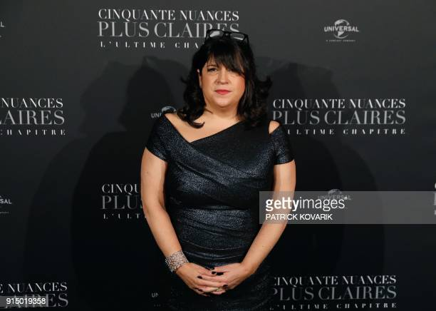 Author Erika Leonard James poses as she arrives to attend 'Fifty Shades Freed 50 Nuances Plus Claires' Premiere at Salle Pleyel in Paris on February...