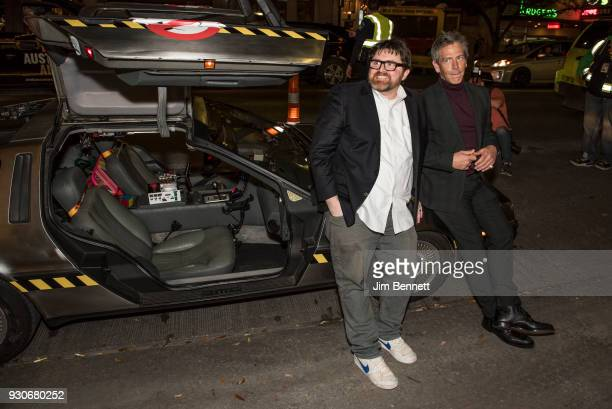 Author Ernest Cline and actor Ben Mendelsohn recline on a Delorean in front of the Paramount Theater at the world premiere of Ready Player One during...