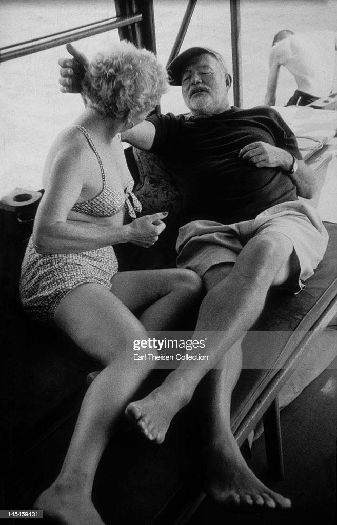 Author Ernest Hemingway and his wife Mary pose for a photo on his boat 'Pilar' circa1956 in Cuba.
