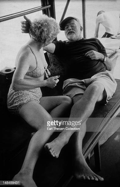 Author Ernest Hemingway and his wife Mary pose for a photo on his boat 'Pilar' circa1956 in Cuba
