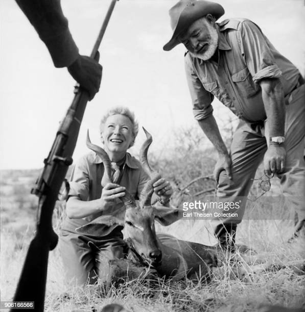 Author Ernest Hemingway and his wife Mary pose for a photo with a trophy while on a big game hunt in September 1952 in Kenya