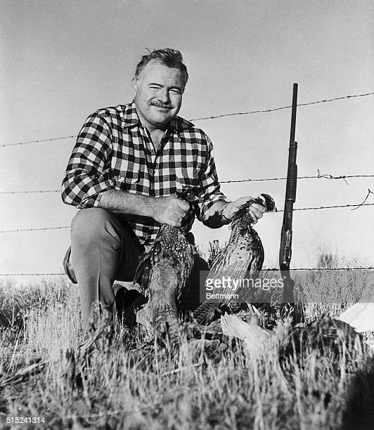 Author Ernest Hemingway displays his limit of pheasants as Sun Valley's fall season comes to a close. He takes time out from work on his latest novel...