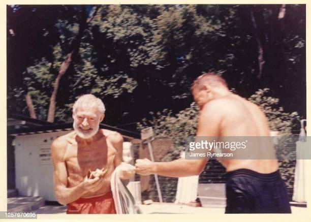Author Ernest Hemingway poses for a photo with Bob Rynearson at the Rynearson family home in June 1961 in Rochester, Minnesota.