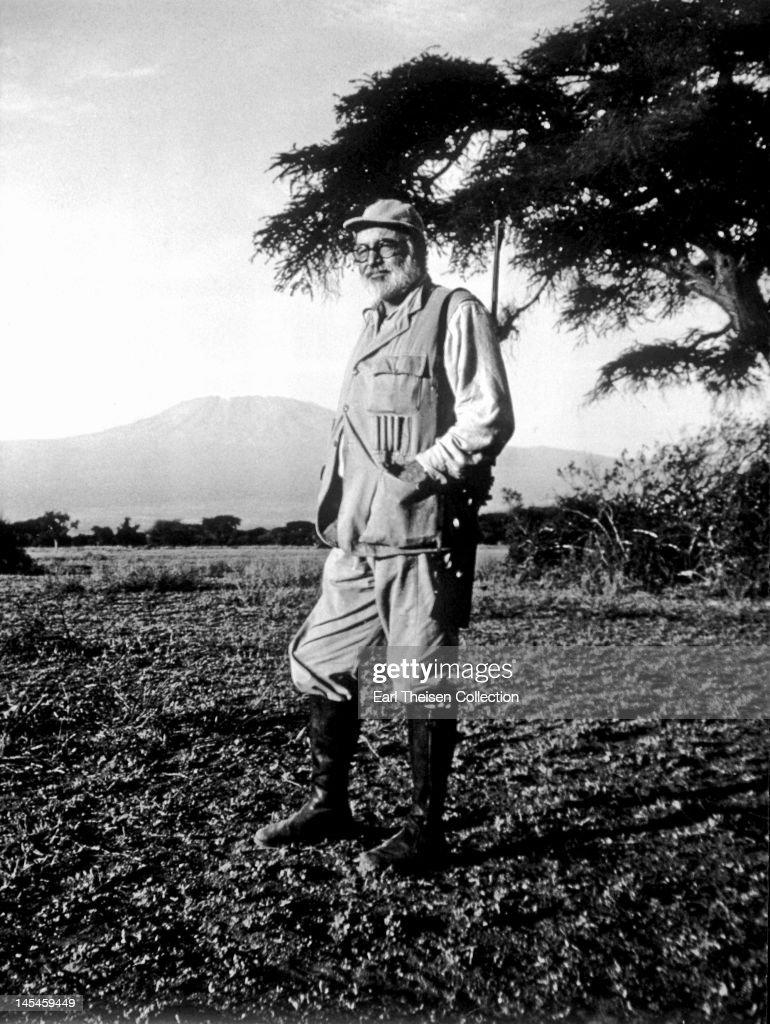 Author Ernest Hemingway poses for a portrait at Mount Kilimanjaro while on a big game hunt in September 1952 in Kenya.