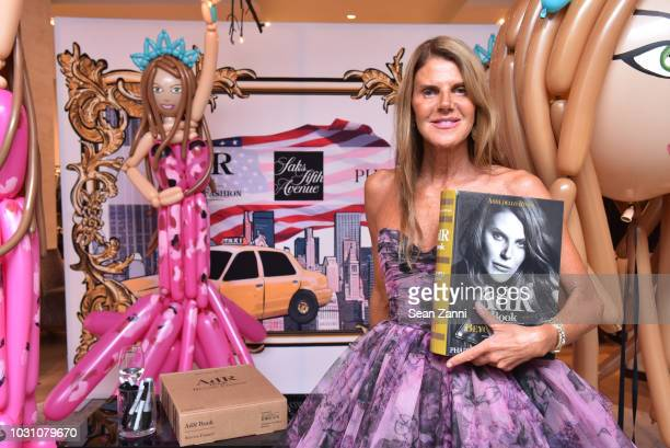 Author Fashion Journalist Anna Dello Russo poses with her book as Saks celebrates AdR Book Beyond Fashion By Anna Dello Russo with a book signing at...