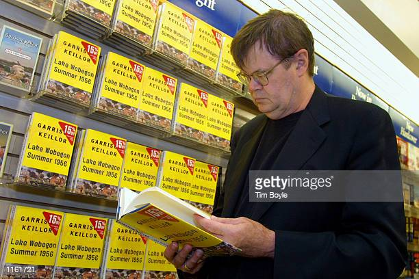Author Garrison Keillor looks at a copy of his new book 'Lake Wobegon Summer 1956' at a Waldenbooks store September 5 2001 in Northbrook IL Keillor...