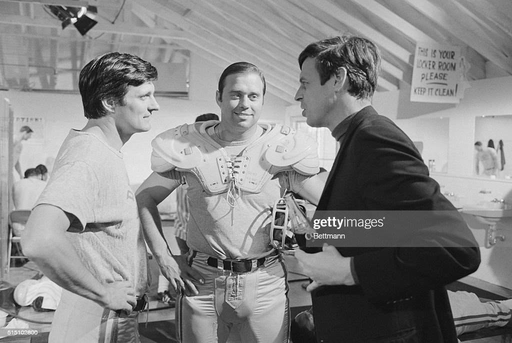 George Plimpton Conferring with Alan Alda on Set : News Photo