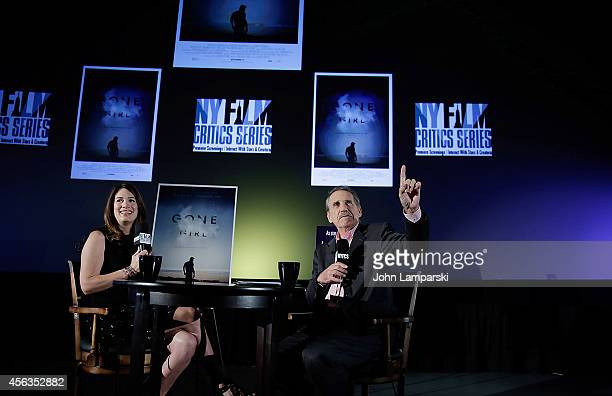 Author Gillian Flynn and NYFCS Host/ Rolling Stone Film Critic Peter Travers speak at the New York Film Critic Series Screening Of Gone Girl at AMC...
