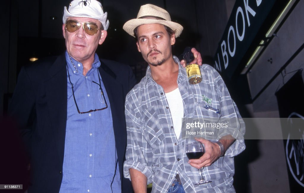 Author Hunter S. Thompson and actor Johnny Depp attend a book signing at Virgin Megastore, New York, 1998.