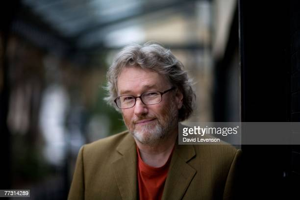 CHELTENHAM ENGLAND OCTOBER 13 Author Iain Banks poses for a portrait at the Cheltenham Literature Festival held at Cheltenham Town Hall on October 13...