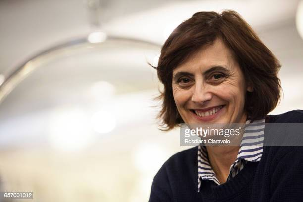 Author Ines De La Fressange poses at the presentaion of her book 'Parisian Chic Look Book What Should I Wear Today' at the Galleria Carla Sozzani on...