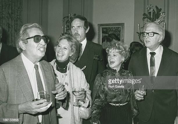 Author Irving Wallace talk show host Dinah Shore author Thomas Thompson Judith Christ and author Sidney Sheldon attend the book party for Thomas...
