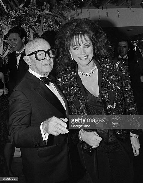 Author Jackie Collins is greeted by Irving Swifty Lazar at his 1989 West Hollywood California Oscar Party held at Spago