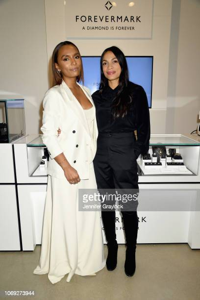 Author Janet Mock and actress Rosario Dawson attend Forevermark Diamonds Females In Focus Photo Exhibition Event on December 6 2018 in New York City