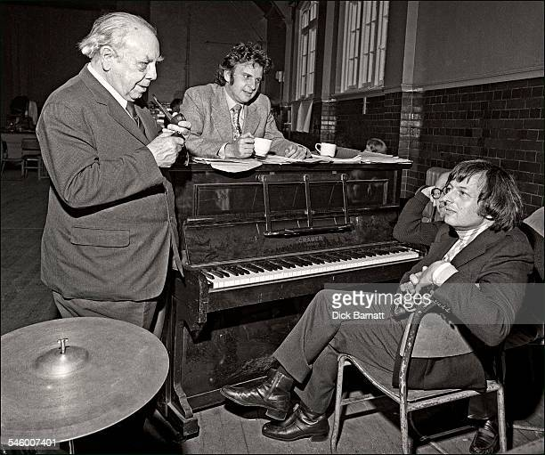 Author JB Priestley with musician composer and conductor Andre Previn and lyricist Johnny Mercer behind him during rehearsals for a musical version...