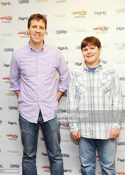 Author Jeff Kinney and actor Robert Capron attend Diary Of A Wimpy Kid Dog Days DVD Release Launch Event at apple seeds on December 15 2012 in New...