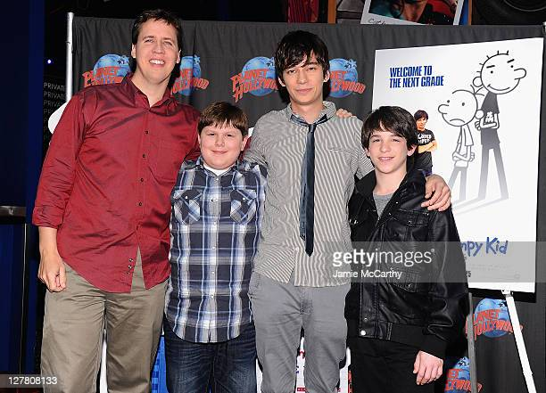 Author Jeff Kinney with actors Robert CapronDevon Bostick and Zack Gordon visit Planet Hollywood Times Square on March 16 2011 in New York City