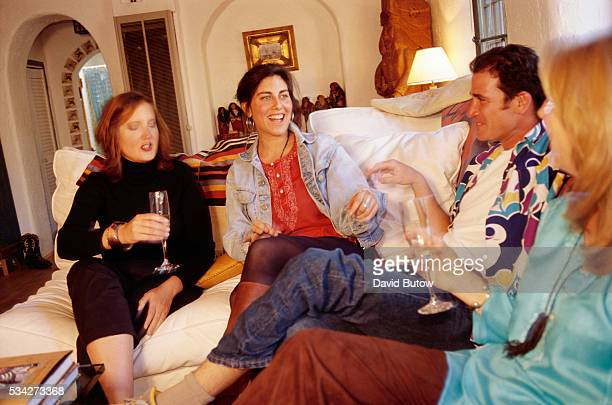 Author Jenny Lauren niece of fashion designer Ralph Lauren laughs with friends at her Santa Fe home Lauren wrote a book about her experiences with...