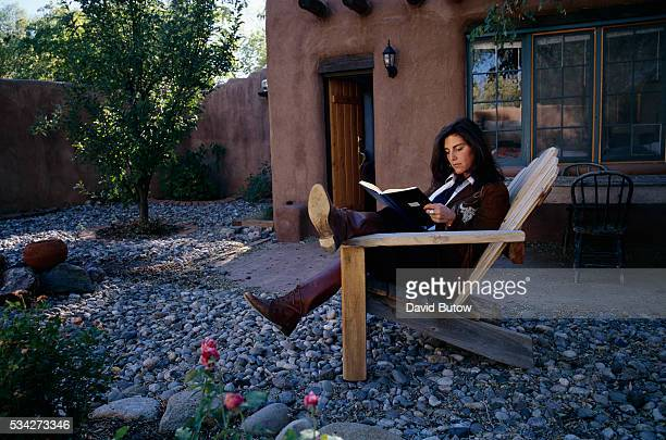 Author Jenny Lauren niece of fashion designer Ralph Lauren reads outside her Santa Fe home Lauren wrote a book about her experiences with anorexia