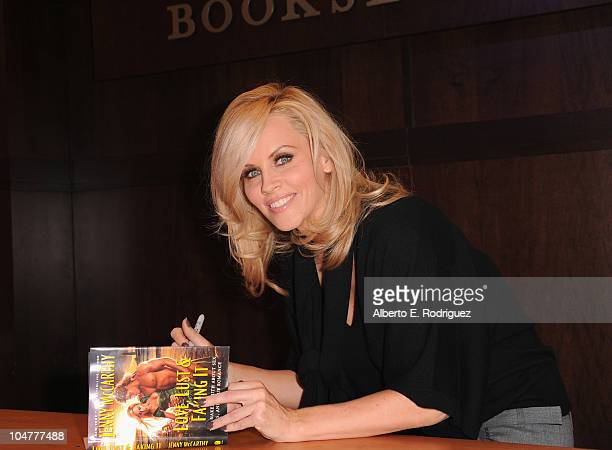 """Author Jenny McCarthy signs copies of her new book """"Love, Lust & Faking It"""" at Barnes and Noble bookstore on October 4, 2010 in Los Angeles,..."""