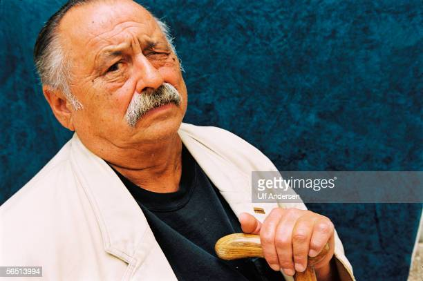 Author Jim Harrison poses while in France during September 2002