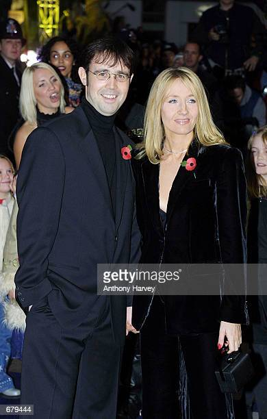 Author JK Rowling and her partner Neil Murray arrive for the world premiere of Harry Potter and the Philosopher's Stone November 4 2001 in London