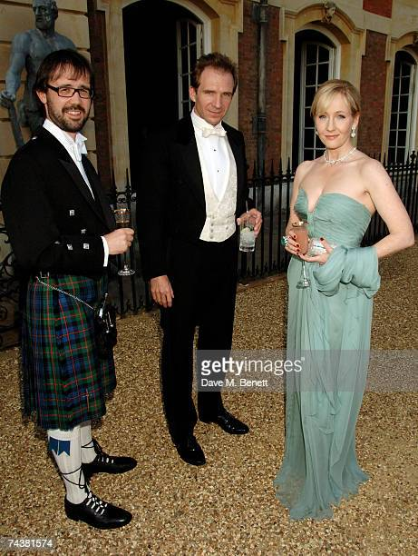 Author JK Rowling her husband Neil Murray and actor Ralph Fiennes arrive at the Raisa Gorbachev Foundation Party at the Hampton Court Palace on June...