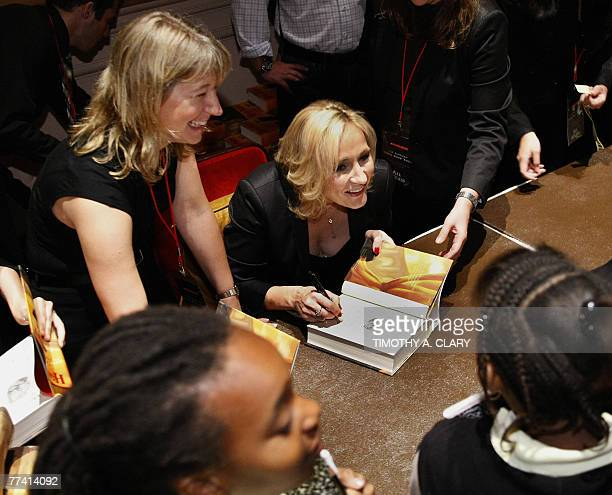 Author JK Rowling signs copies of her book Harry Potter and the Deathly Hallows during the final stop on the JK Rowling Open Book Tour held at...
