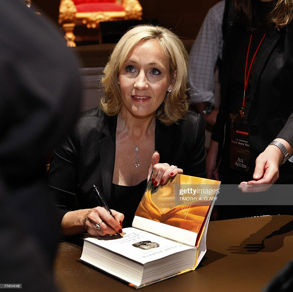 Author J.K. Rowling signs copies of her : News Photo