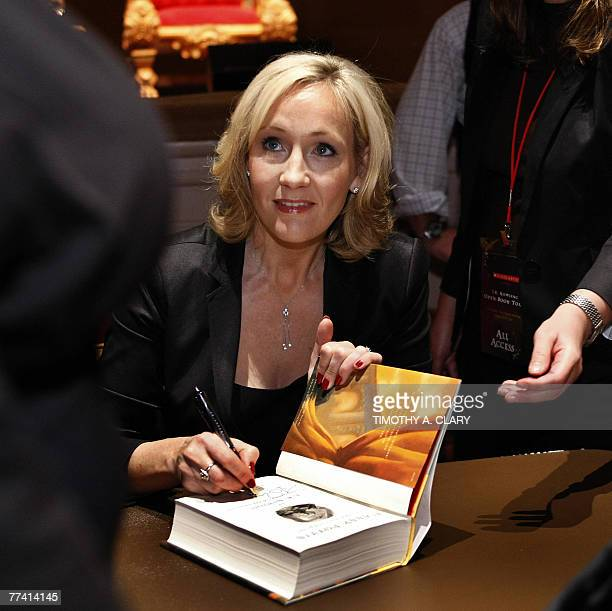 Author JK Rowling signs copies of her book 'Harry Potter and the Deathly Hallows' during the final stop on the 'JK Rowling Open Book Tour' held at...