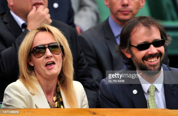 Author JK Rowling with her husband Neil Murray in the Royal Box on Center Court on the second day of the 2012 Wimbledon Championships tennis...