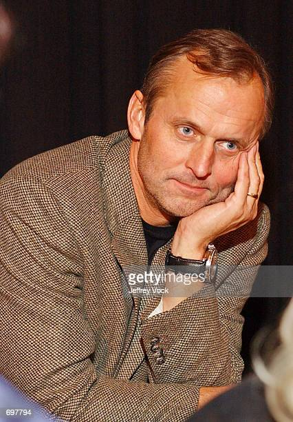 Author John Grisham attends a benefit reading for actor Frank Muller at Town Hall February 2 2002 in New York City Actor and audiobook narrator Frank...