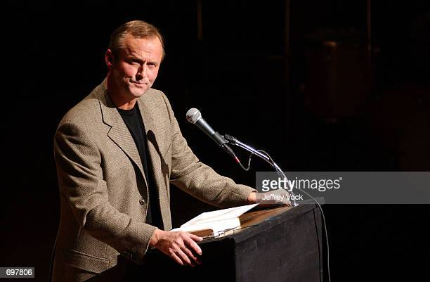 Author John Grisham attends a benefit reading for Frank Muller at Town Hall February 2 2002 in New York City Actor and audiobook narrator Frank...