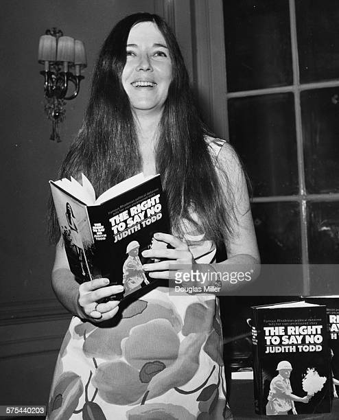 Author Judith Todd, daughter of former Rhodesian Prime Minister Garfield Todd, reading a copy of her new book 'The Right to Say No' at a press...