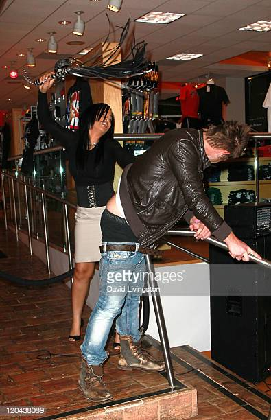 Author Karrine Steffans and musician Chris Bundas attend a party and signing for Steffans' book SatisFaction at Hustler Hollywood on August 5 2011 in...