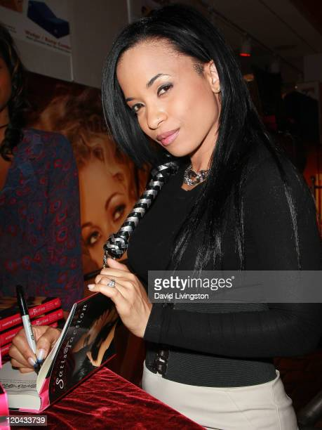 Author Karrine Steffans attends a party and signing for her book SatisFaction at Hustler Hollywood on August 5 2011 in West Hollywood California